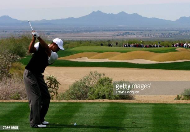 Tiger Woods hits his tee shot on the third hole during the first round matches of the WGCAccenture Match Play Championship at The Gallery at Dove...