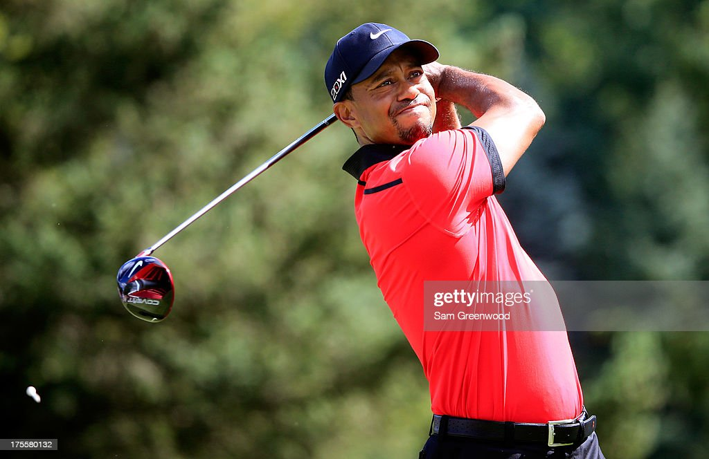 Tiger Woods hits off the 13th tee during the Final Round of the World Golf Championships-Bridgestone Invitational at Firestone Country Club South Course on August 4, 2013 in Akron, Ohio.