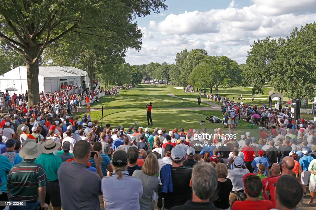 <a gi-track='captionPersonalityLinkClicked' href=/galleries/search?phrase=Tiger+Woods&family=editorial&specificpeople=157537 ng-click='$event.stopPropagation()'>Tiger Woods</a> hits off the 18th tee during the Final Round of the World Golf Championships-Bridgestone Invitational at Firestone Country Club South Course on August 4, 2013 in Akron, Ohio.