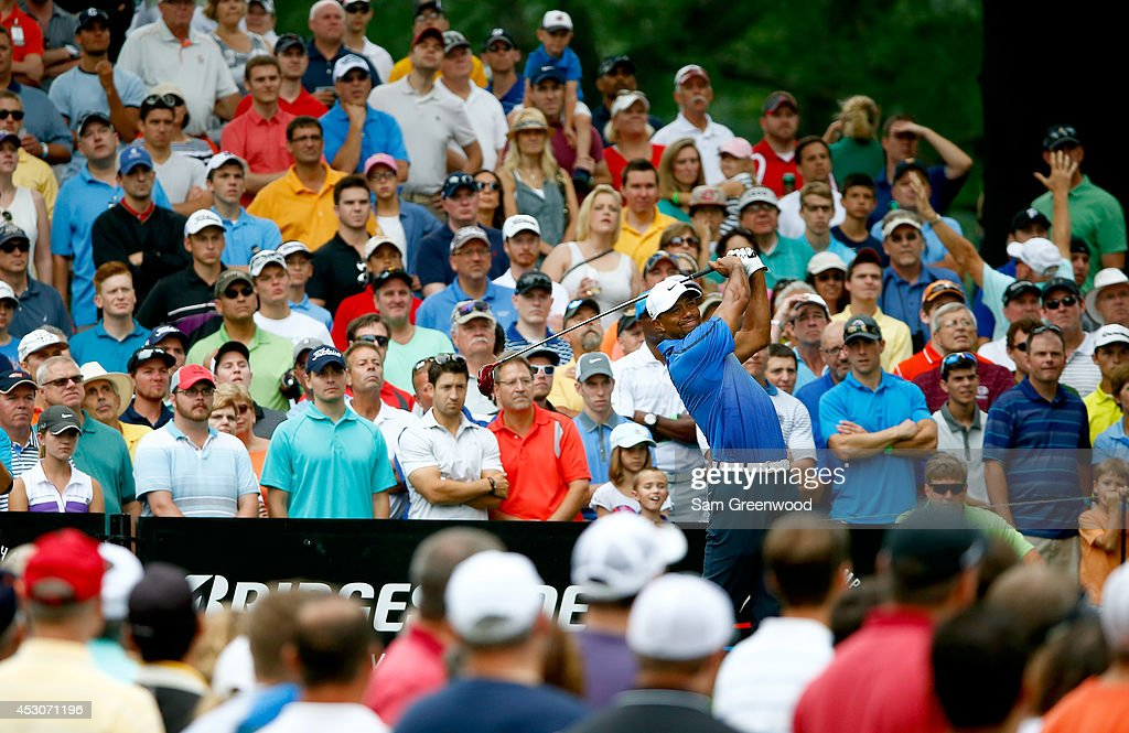 Tiger Woods hits off the 18th tee during the third round of the World Golf Championships-Bridgestone Invitational at Firestone Country Club South Course on August 2, 2014 in Akron, Ohio.