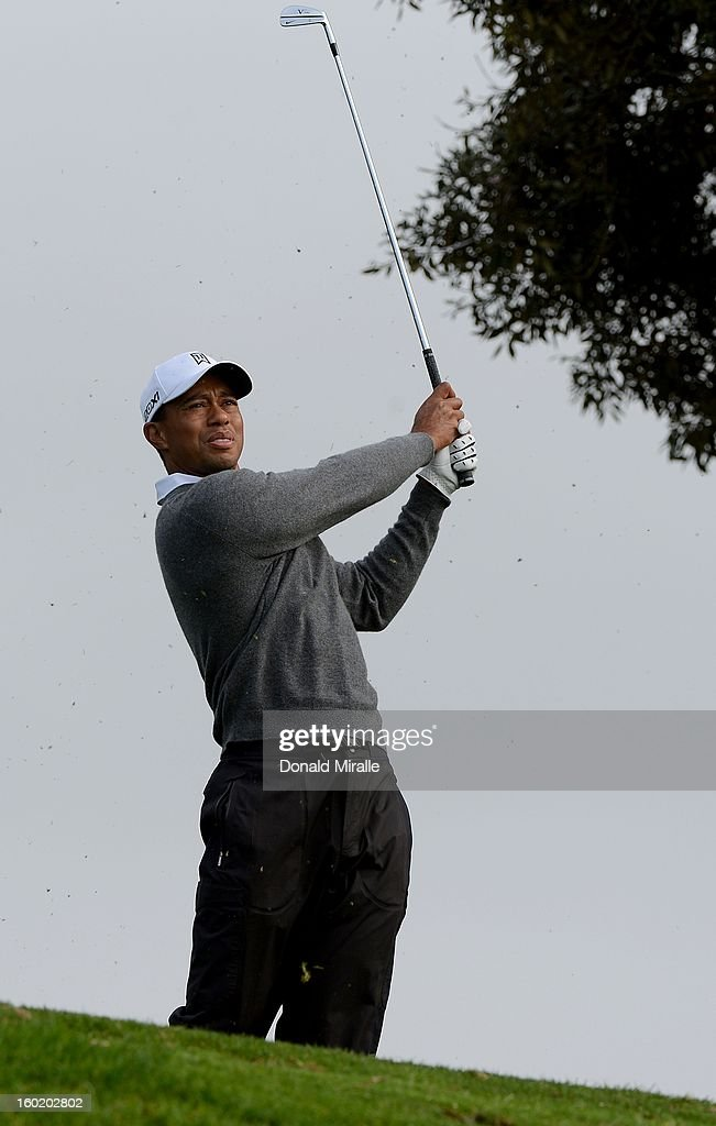 Tiger Woods hits off the fairway during the Third Round at the Farmers Insurance Open at Torrey Pines South Golf Course on January 27, 2013 in La Jolla, California.