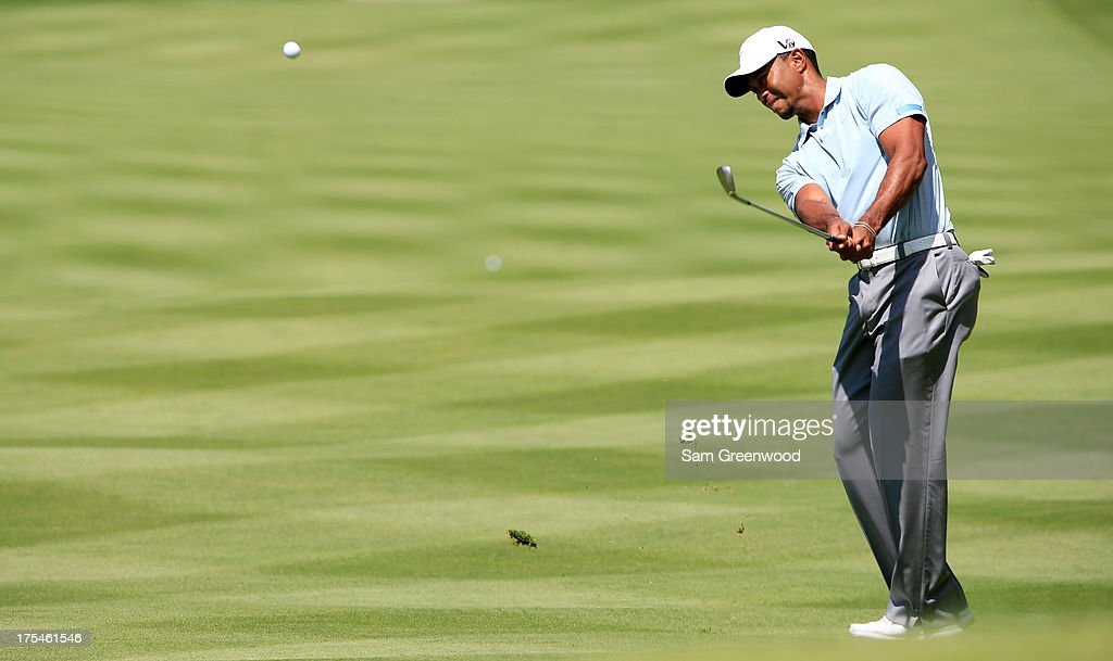 Tiger Woods hits off the fourth fairway during the Third Round of the World Golf Championships-Bridgestone Invitational at Firestone Country Club South Course on August 3, 2013 in Akron, Ohio.