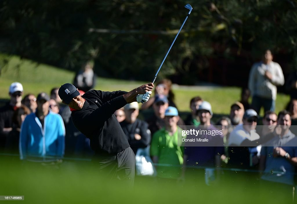 Tiger Woods hits off the rough during the Final Round at the Farmers Insurance Open at Torrey Pines Golf Course on January 28, 2013 in La Jolla, California.