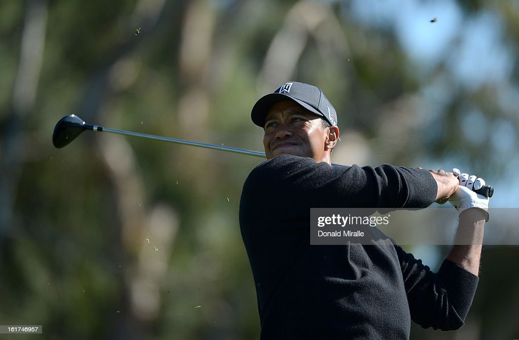 Tiger Woods hits off the tee box during the Final Round at the Farmers Insurance Open at Torrey Pines Golf Course on January 28, 2013 in La Jolla, California.
