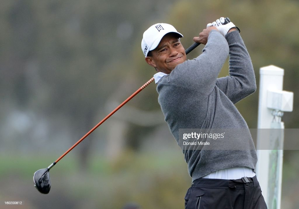 <a gi-track='captionPersonalityLinkClicked' href=/galleries/search?phrase=Tiger+Woods&family=editorial&specificpeople=157537 ng-click='$event.stopPropagation()'>Tiger Woods</a> hits off the tee box during the Third Round at the Farmers Insurance Open at Torrey Pines South Golf Course on January 27, 2013 in La Jolla, California.