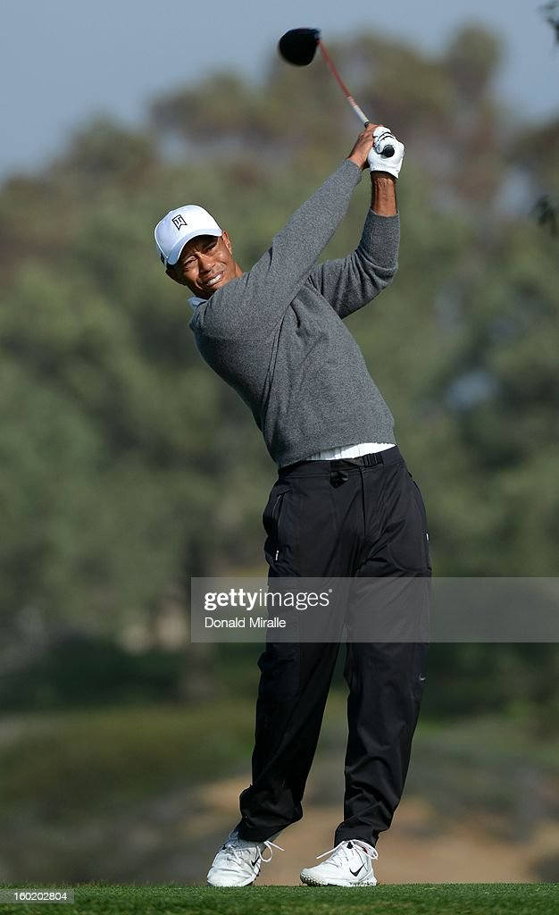 Tiger Woods hits off the tee box during the Third Round at the Farmers Insurance Open at Torrey Pines South Golf Course on January 27, 2013 in La Jolla, California.