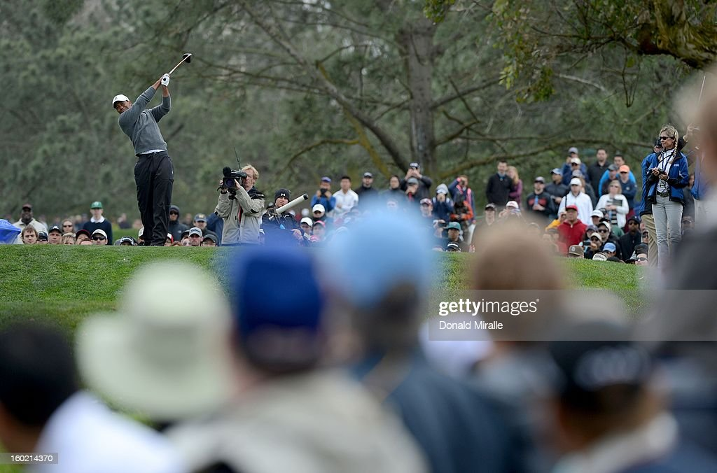 Tiger Woods hits off the tee box during the Third Round at the Farmers Insurance Open at Torrey Pines Golf Course on January 27, 2013 in La Jolla, California.