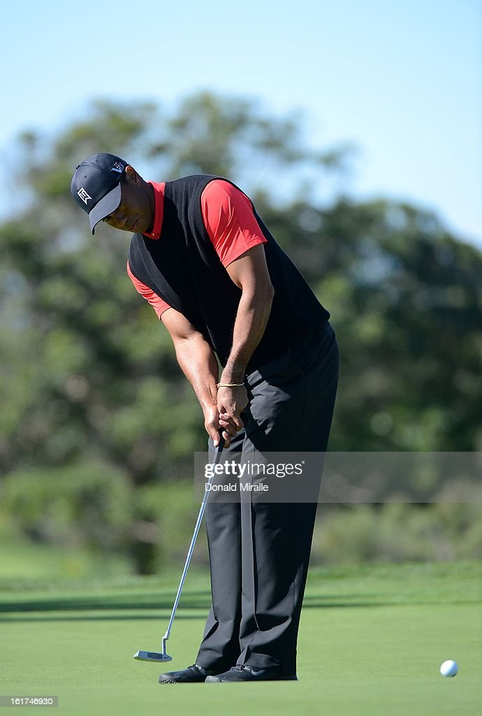Tiger Woods hits on the green during the Final Round at the Farmers Insurance Open at Torrey Pines Golf Course on January 28, 2013 in La Jolla, California.
