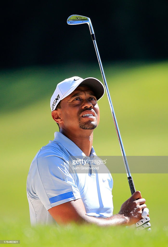 Tiger Woods hits out of a bunker on the 16th fairway during the Third Round of the World Golf Championships-Bridgestone Invitational at Firestone Country Club South Course on August 3, 2013 in Akron, Ohio.