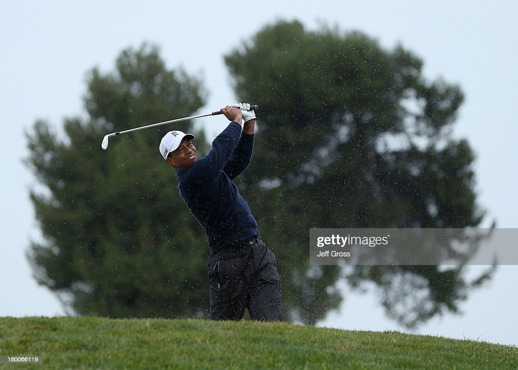 Tiger Woods hits out of a fairway bunker on the eighth hole during the second round of the Farmers Insurance Open at Torrey Pines North Golf Course on January 25, 2013 in La Jolla, California.