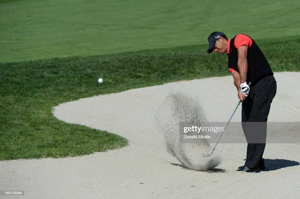 Tiger Woods hits out of the 10th bunker during the Final Round at the Farmers Insurance Open at Torrey Pines Golf Course on January 28, 2013 in La Jolla, California.