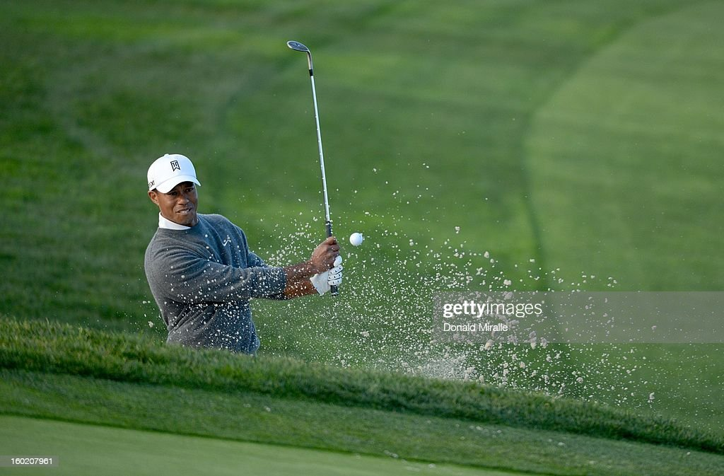 Tiger Woods hits out of the 5th green bunker during the Final Round at the Farmers Insurance Open at Torrey Pines Golf Course on January 27, 2013 in La Jolla, California.
