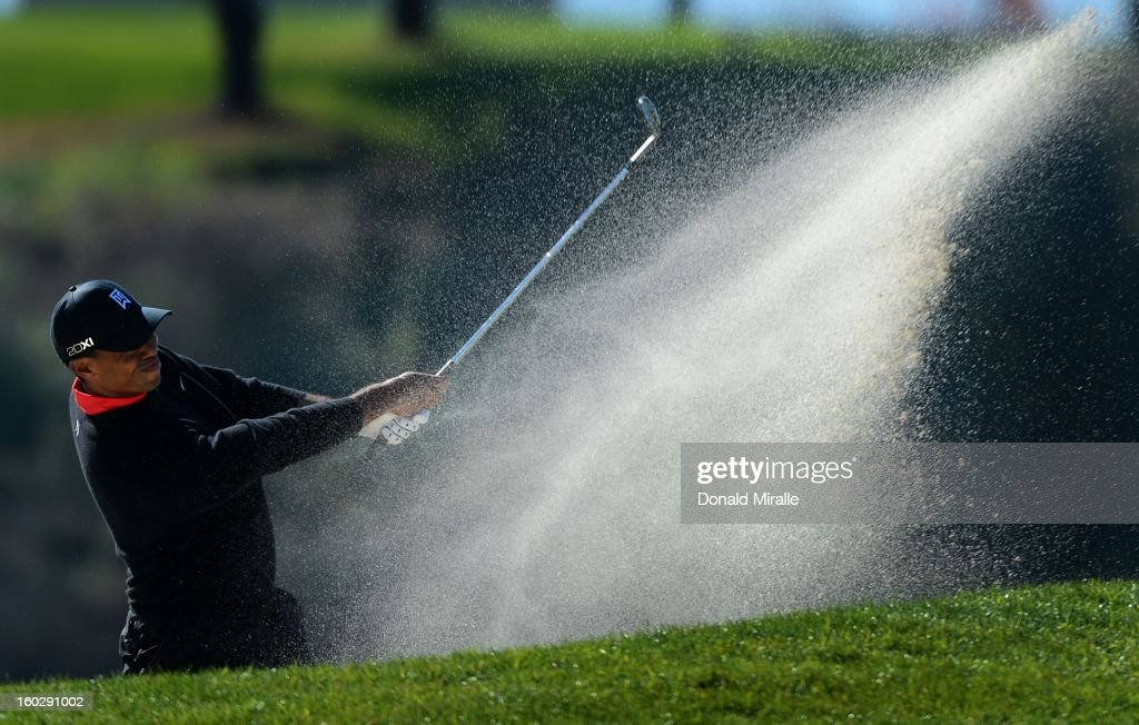 <a gi-track='captionPersonalityLinkClicked' href=/galleries/search?phrase=Tiger+Woods&family=editorial&specificpeople=157537 ng-click='$event.stopPropagation()'>Tiger Woods</a> hits out of the bunker en route to his -14 under victory during the Final Round at the Farmers Insurance Open at Torrey Pines Golf Course on January 28, 2013 in La Jolla, California.