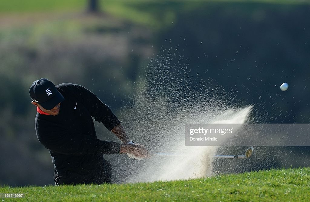 Tiger Woods hits out of the bunker en route to his -14 under victory during the Final Round at the Farmers Insurance Open at Torrey Pines Golf Course on January 28, 2013 in La Jolla, California.