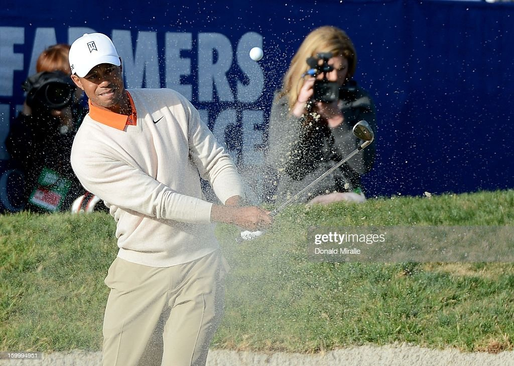 Tiger Woods hits out of the bunker on the 18th hole during the first round at the Farmers Insurance Open at Torrey Pines Golf Course on January 24, 2013 in La Jolla, California.