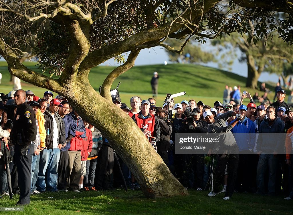 <a gi-track='captionPersonalityLinkClicked' href=/galleries/search?phrase=Tiger+Woods&family=editorial&specificpeople=157537 ng-click='$event.stopPropagation()'>Tiger Woods</a> hits out of the rough on the 4th hole during the Final Round at the Farmers Insurance Open at Torrey Pines Golf Course on January 27, 2013 in La Jolla, California.