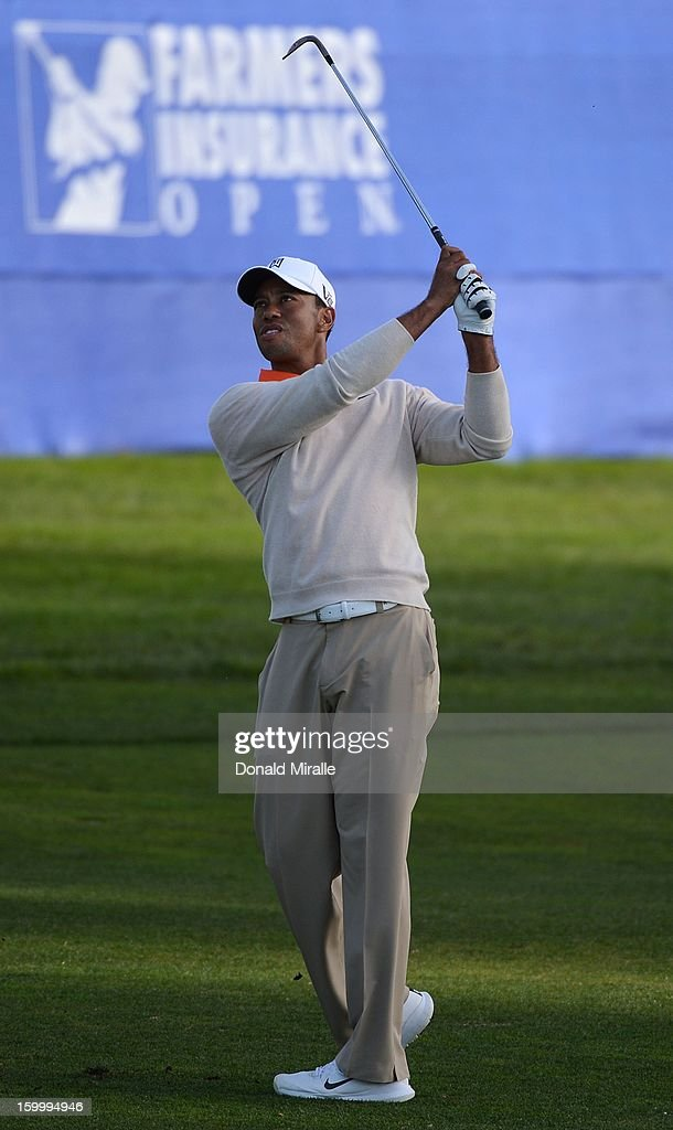 Tiger Woods hits the fairway on the 18th hole during the first round at the Farmers Insurance Open at Torrey Pines Golf Course on January 24, 2013 in La Jolla, California.