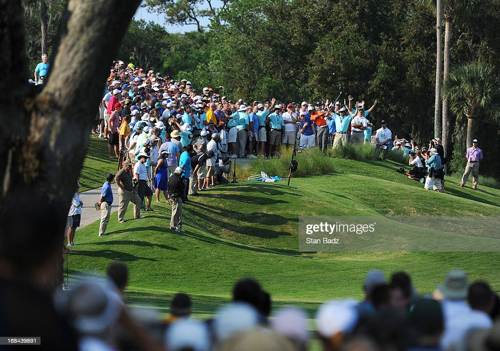 Tiger Woods hits to the 14th green during the first round of THE PLAYERS Championship on THE PLAYERS Stadium Course at TPC Sawgrass on May 9, 2013 in Ponte Vedra Beach, Florida.