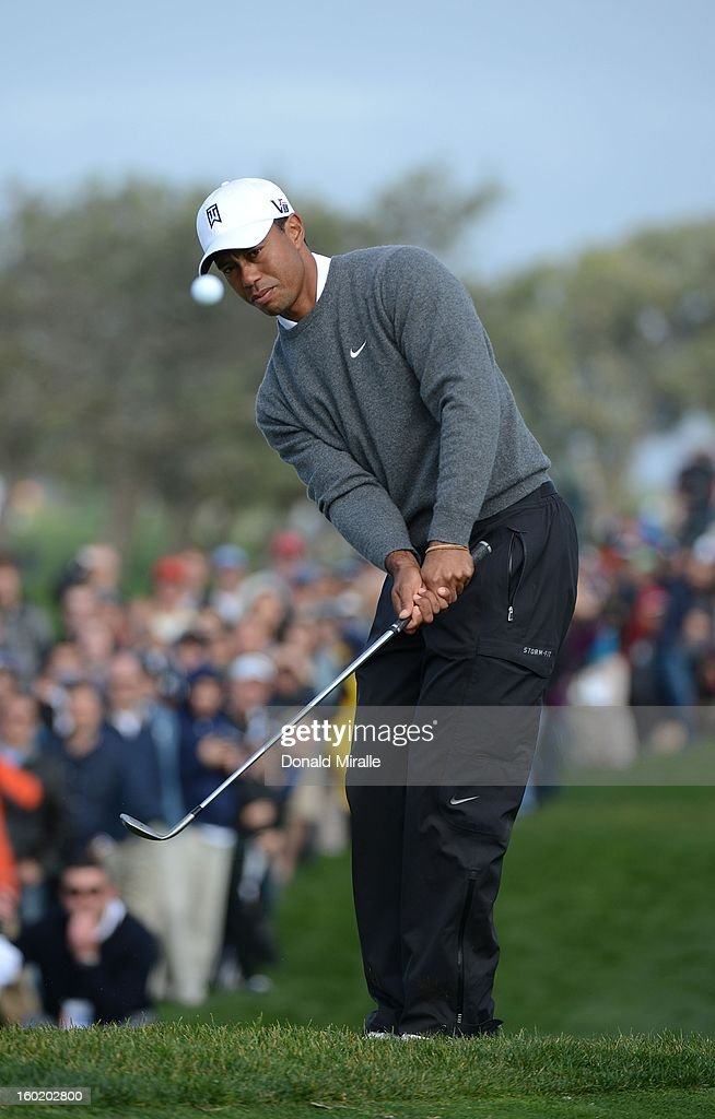<a gi-track='captionPersonalityLinkClicked' href=/galleries/search?phrase=Tiger+Woods&family=editorial&specificpeople=157537 ng-click='$event.stopPropagation()'>Tiger Woods</a> hits towards the green during the Third Round at the Farmers Insurance Open at Torrey Pines South Golf Course on January 27, 2013 in La Jolla, California.