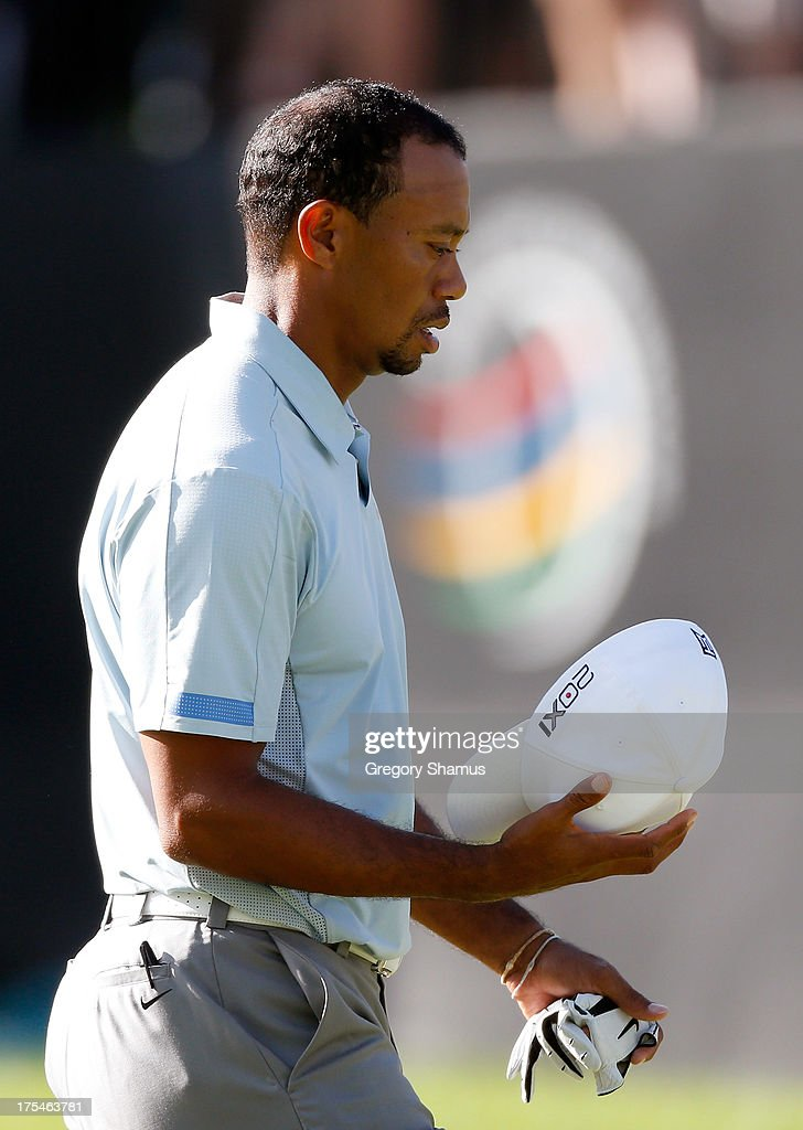 Tiger Woods holds his hat after finishing the 18th hole during the Third Round of the World Golf Championships-Bridgestone Invitational at Firestone Country Club South Course on August 3, 2013 in Akron, Ohio.