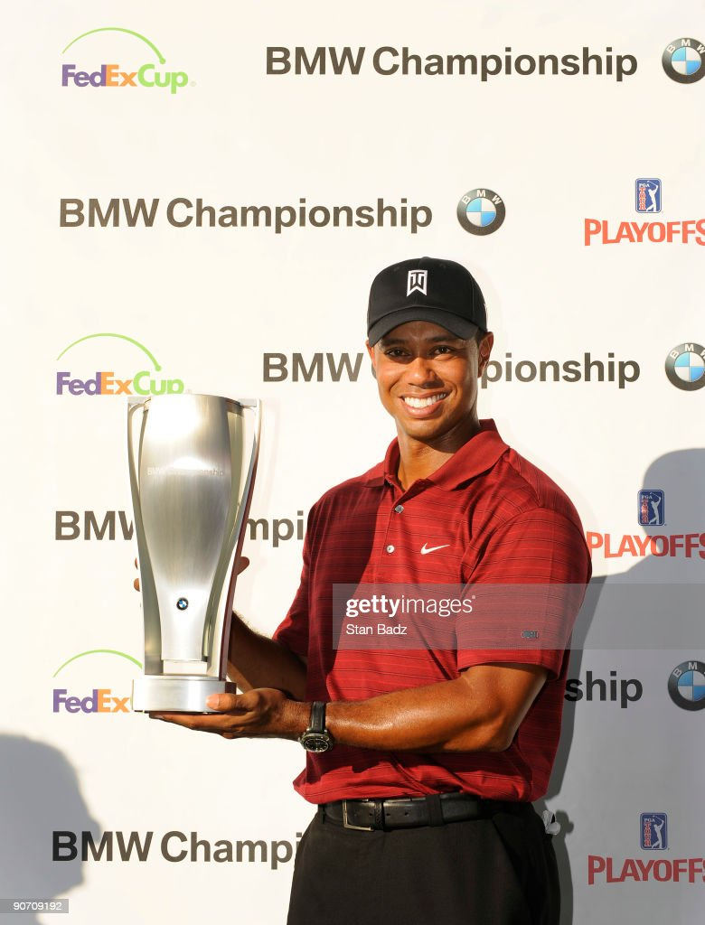 Tiger Woods holds the BMW Champions Trophy after winning the final round of the BMW Championship held at Cog Hill Golf Country Club on September 13...