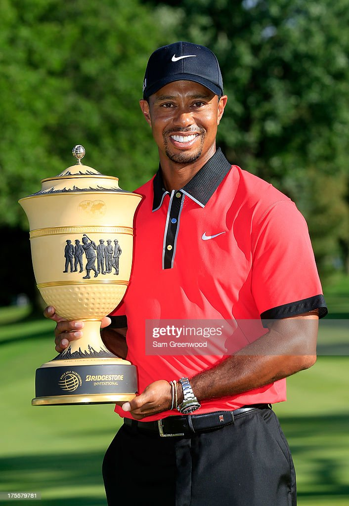 <a gi-track='captionPersonalityLinkClicked' href=/galleries/search?phrase=Tiger+Woods&family=editorial&specificpeople=157537 ng-click='$event.stopPropagation()'>Tiger Woods</a> holds the Gary Player Cup trophy after the Final Round of the World Golf Championships-Bridgestone Invitational at Firestone Country Club South Course on August 4, 2013 in Akron, Ohio. Woods won the tournament with a score of -15.