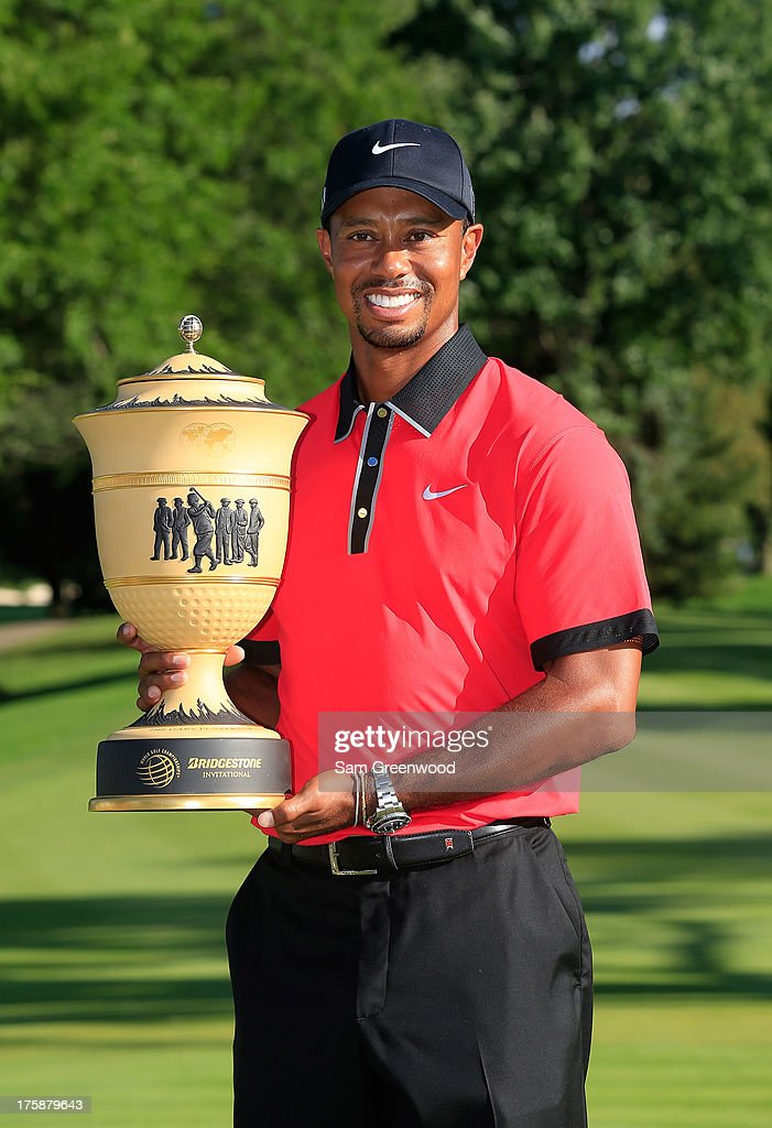 Tiger Woods holds the Gary Player Cup trophy after the Final Round of the World Golf Championships-Bridgestone Invitational at Firestone Country Club South Course on August 4, 2013 in Akron, Ohio. Woods won the tournament with a score of -15.