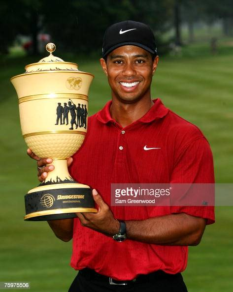 Tiger Woods holds the trophy after winning the WGCBridgestone Invitational at Firestone Country Club August 5 2007 in Akron Ohio