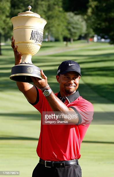 Tiger Woods holds up the Gary Player Cup trophy after the Final Round of the World Golf ChampionshipsBridgestone Invitational at Firestone Country...