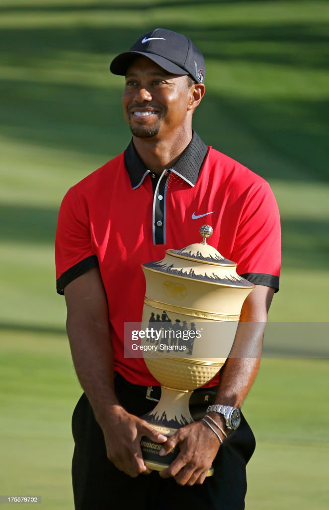 Tiger Woods holds up the Gary Player Cup trophy after the Final Round of the World Golf Championships-Bridgestone Invitational at Firestone Country Club South Course on August 4, 2013 in Akron, Ohio. Woods won the tournament with a score of -15.