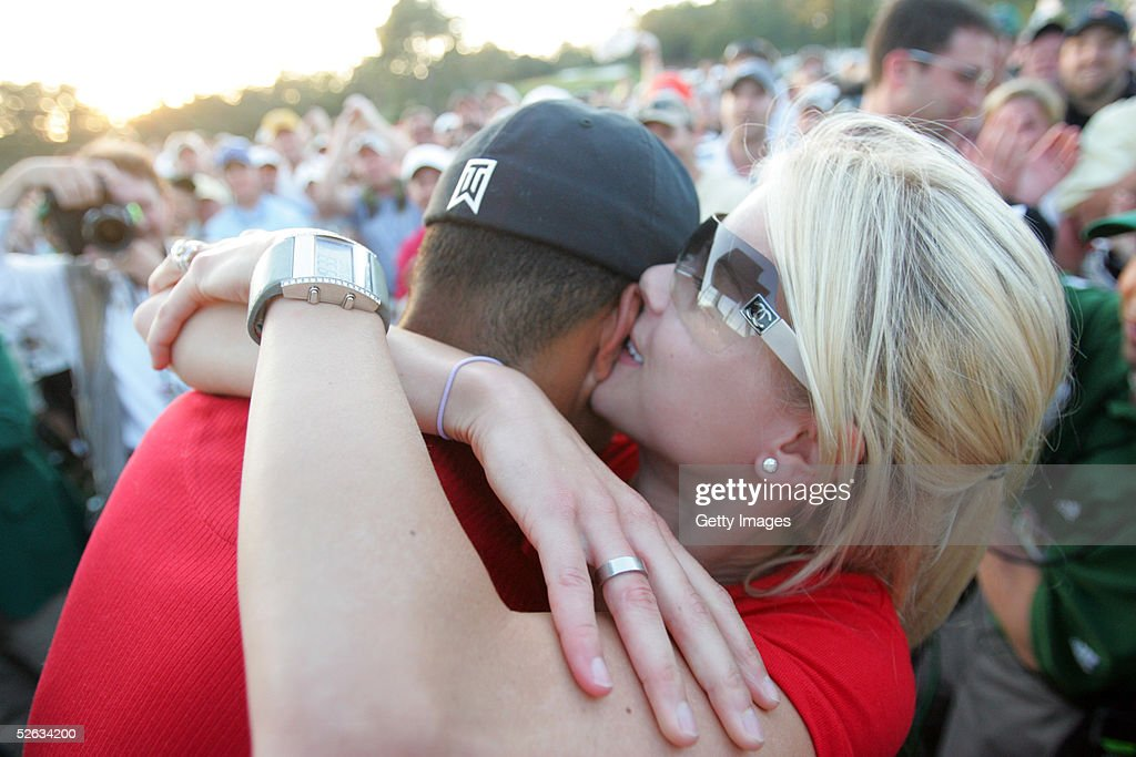 <a gi-track='captionPersonalityLinkClicked' href=/galleries/search?phrase=Tiger+Woods&family=editorial&specificpeople=157537 ng-click='$event.stopPropagation()'>Tiger Woods</a> is kissed by wife Elin after winning the 2005 Masters on April 10, 2005 at Augusta National Golf Course in Augusta, Georgia.