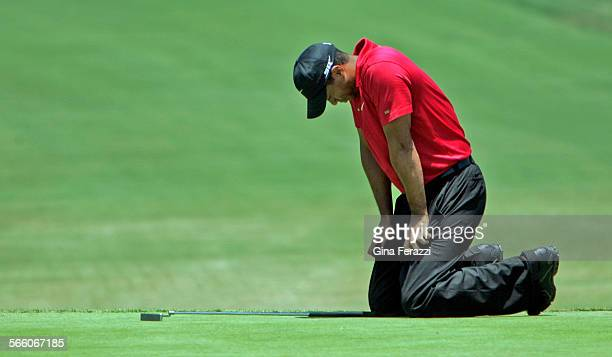 Tiger Woods leans over his knees after missing a birdie putt on the 7th hole in a sudden death the playoff during the US Open at Torrey Pines in La...