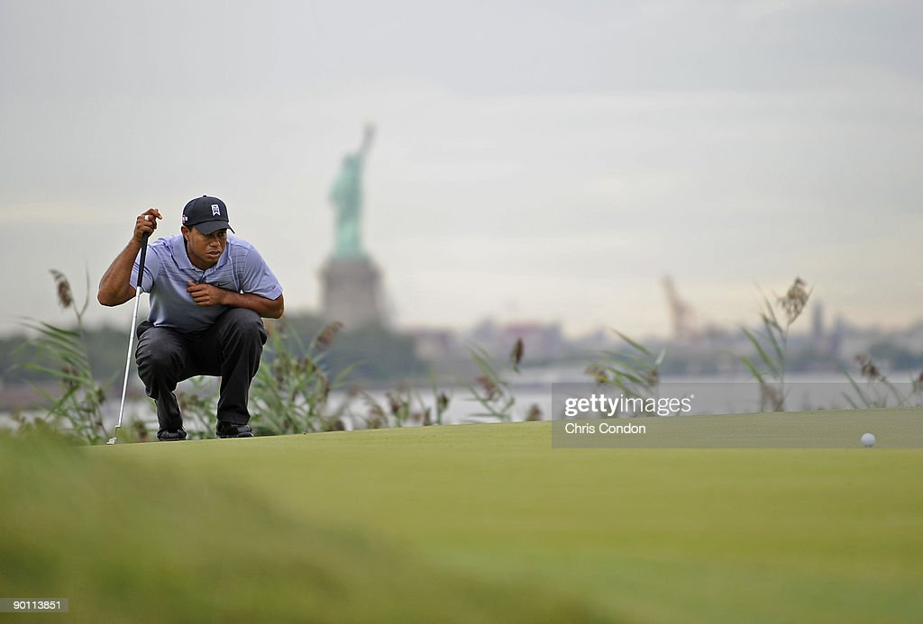 Tiger Woods lines up a par putt on the 14th green during the first round of The Barclays at Liberty National Golf Club on August 27 2009 in Jersey...