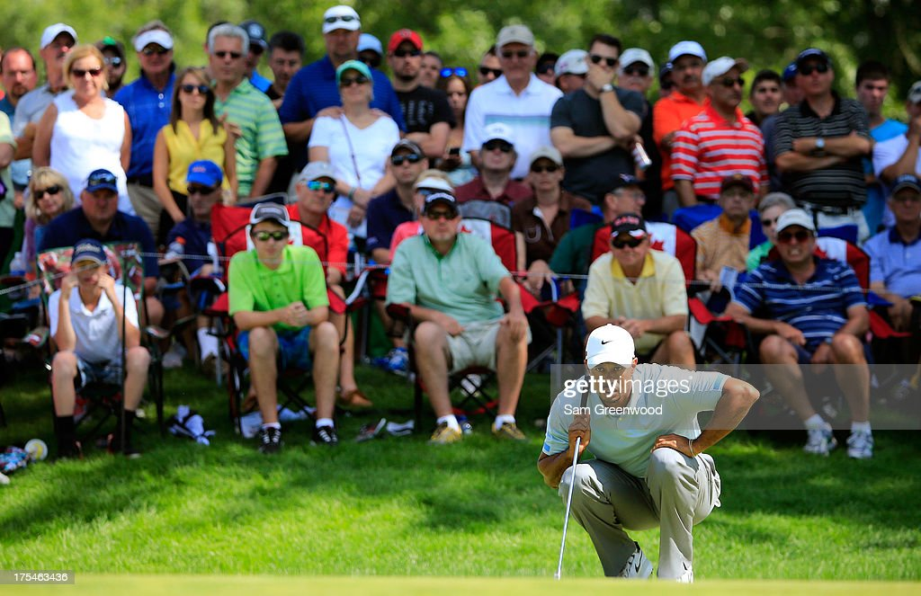 Tiger Woods lines up a putt on the 12th green during the Third Round of the World Golf Championships-Bridgestone Invitational at Firestone Country Club South Course on August 3, 2013 in Akron, Ohio.