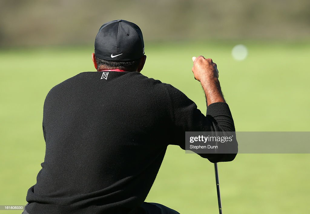 Tiger Woods lines up a putt on the 13th hole during the final round of the Farmers Insurance Open on the South Course at Torrey Pines Golf Course on January 28, 2013 in La Jolla, California.