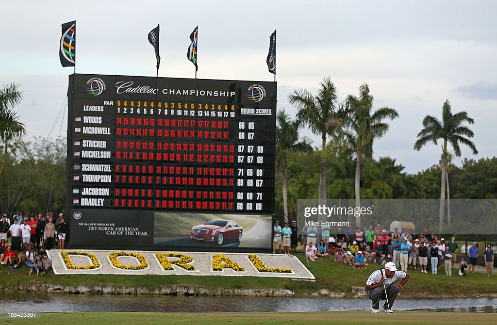 Tiger Woods lines up a putt on the 18th hole during the third round of the WGC-Cadillac Championship at the Trump Doral Golf Resort & Spa in on March 9, 2013 in Doral, Florida.