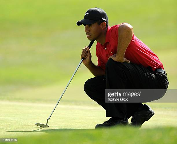 Tiger Woods lines up a putt on the first hole during his 18hole playoff against Rocco Mediate at the 108th US Open golf tournament at Torrey Pines...