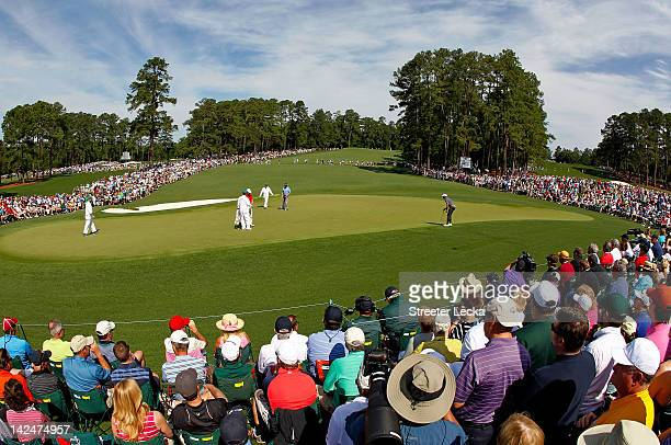 Tiger Woods lines up a putt on the second hole during the first round of the 2012 Masters Tournament at Augusta National Golf Club on April 5 2012 in...
