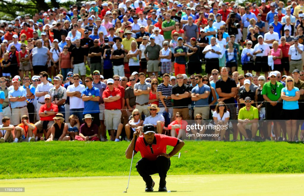Tiger Woods lines up a putt on the seventh green during the Final Round of the World Golf Championships-Bridgestone Invitational at Firestone Country Club South Course on August 4, 2013 in Akron, Ohio.