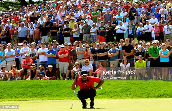 Tiger Woods lines up a putt on the seventh green during the Final Round of the World Golf ChampionshipsBridgestone Invitational at Firestone Country...