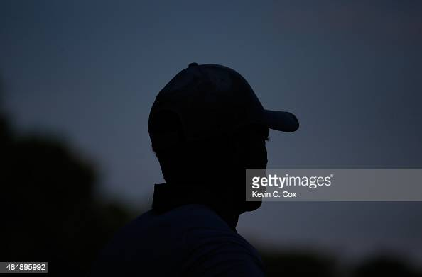Tiger Woods lines up his birdie putt on the 18th green during the third round of the Wyndham Championship at Sedgefield Country Club on August 22...