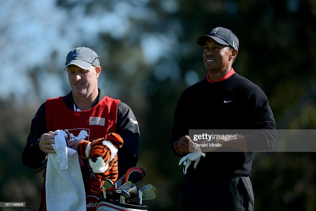 Tiger Woods looks down the fairway with caddie Joe LaCava during the Final Round at the Farmers Insurance Open at Torrey Pines Golf Course on January 28, 2013 in La Jolla, California.