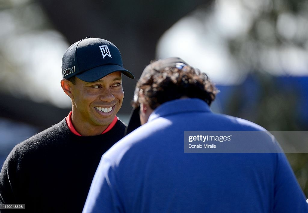 Tiger Woods looks off the practice putting green during the Final Round at the Farmers Insurance Open at Torrey Pines Golf Course on January 28, 2013 in La Jolla, California.