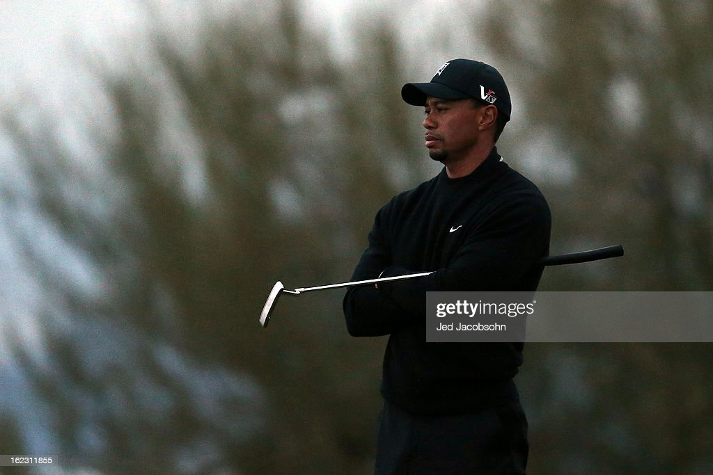 Tiger Woods looks on from the 17th green during the first round of the World Golf Championships - Accenture Match Play at the Golf Club at Dove Mountain on February 21, 2013 in Marana, Arizona. Round one play was suspended on February 20 due to inclimate weather and is scheduled to be continued today.