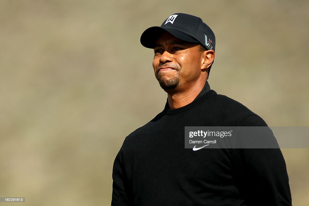 Tiger Woods looks on from the tee box on the second hole during the first round of the World Golf Championships - Accenture Match Play at the Golf Club at Dove Mountain on February 21, 2013 in Marana, Arizona. Round one play was suspended on February 20 due to inclimate weather and is scheduled to be continued today.