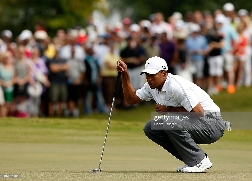 Tiger Woods looks over a putt on the first green during the third round of the World Golf Championships-Cadillac Championship at the Trump Doral Golf Resort & Spa on March 9, 2013 in Doral, Florida.