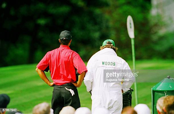 Tiger Woods looks over the course with his caddie at his side during the 1997 Masters Tournament at Augusta National Golf Club in April in Augusta...