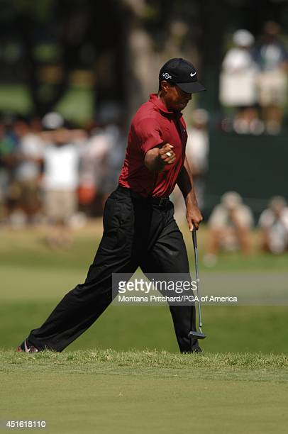 Tiger Woods makes his birdie putt on No 8 during the Final Round of the 89th PGA Championship held at Southern Hills Country Club in Tulsa Oklahoma...
