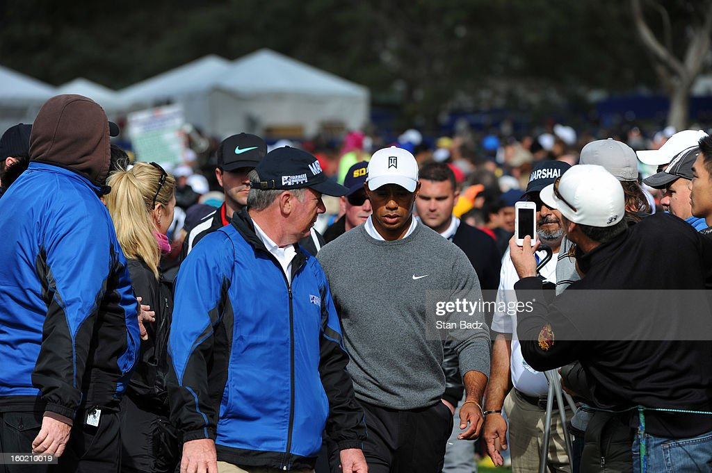 Tiger Woods makes his way through fans on the 16th hole during the third round of the Farmers Insurance Open at Torrey Pines Golf Course on January 27, 2013 in La Jolla, California.