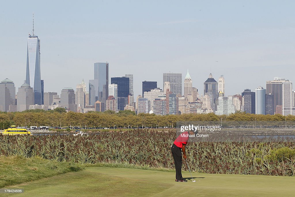 Tiger Woods makes par on the 14th green during the fourth round of The Barclays held at Liberty National Golf Club on August 25 2013 in Jersey City...